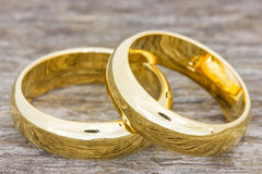 Wedding rings on a wooden floor Stock Images