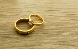 Wedding rings on wooden surface. Symbol of wedding and couple, agreement and together is concept royalty free stock photo