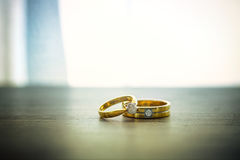 Wedding rings on wooden surface. Symbol of wedding and couple, agreement and together is concept Royalty Free Stock Image