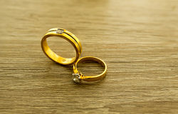 Wedding rings on wooden surface. Symbol of wedding and couple, agreement and together is concept royalty free stock photos