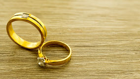 Wedding rings on wooden surface. Symbol of wedding and couple, agreement and together is concept stock images