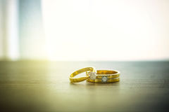 Wedding rings on wooden surface. Symbol of wedding and couple, agreement and together is concept Royalty Free Stock Images