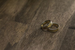 Wedding rings. On the wooden table Stock Photos