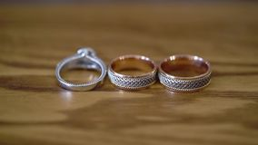Wedding rings at wooden table. Wedding rings at wooden background stock video footage