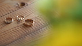 Wedding rings on a wooden table stock video