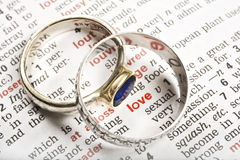 Wedding rings and the word love Royalty Free Stock Photo