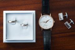 Wedding rings and Wristwatch Royalty Free Stock Photos