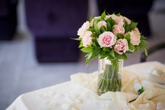 Wedding bouquet from pink roses with green on the table. Marriage ceremony. Wedding romantic bouquet from pink roses with green on the table. Marriage ceremony Stock Photos