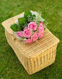 Wedding rose bouquet on a basket. Bouquet of newly-married couple on basket Royalty Free Stock Image