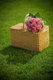 Wedding rose bouquet on a basket. Bouquet of newly-married couple on basket Stock Image