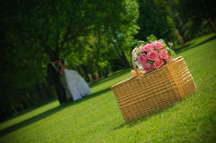 Wedding rose bouquet on a basket. Bouquet of newly-married couple on a basket Stock Photos
