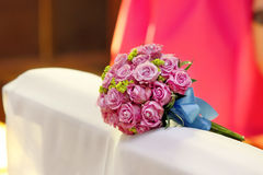 Wedding rose bouquet on hassock in church Royalty Free Stock Images