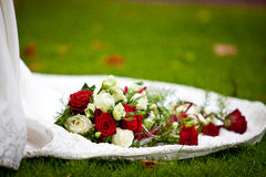 Wedding roses on dress Stock Images