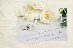 Wedding roses and rings on invitation Royalty Free Stock Image