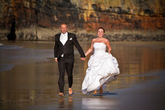 Wedding run on the beach Stock Photography