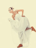 Wedding. Running bride funny woman in sport shoes Stock Images