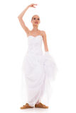 Wedding. Running bride funny woman in sport shoes Royalty Free Stock Photography