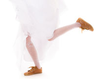 Wedding. Running bride woman legs in sport shoes Stock Photos