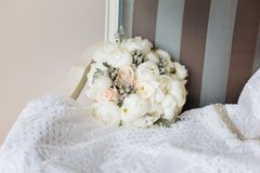 Wedding rustic bouquet on vintage striped chair. Bridal room interior. Bridal morning concept in pastel colors royalty free stock images