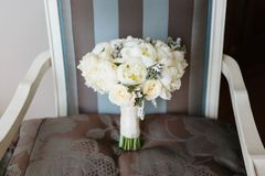 Wedding rustic bouquet on vintage striped chair. Bridal room interior. Bridal morning concept in pastel colors royalty free stock photo