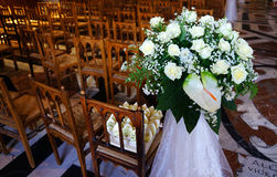 Wedding's floral decorations. Interiors of a church with floral decorations into the wedding's day Royalty Free Stock Photos