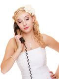 Wedding. Sad woman unhappy bride talking on phone Stock Images