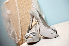 Wedding sandals. White wedding sandals and bridal veil Royalty Free Stock Photo