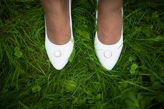 Wedding sandals and weddings  rings. Wedding sandals and weddings rings on the grass Royalty Free Stock Photo