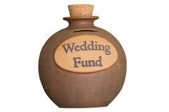 Wedding Savings Fund. A brown and tan piggy bank with the words wedding fund stamped on the front. Designed for people that are saving up some change for a stock images