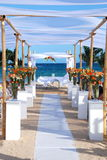 Wedding by the sea beach. Tropical beach and ocean with bamboo poles holding sheer curtains set up for a wedding Royalty Free Stock Photo
