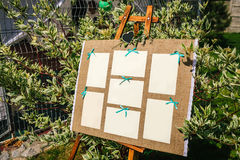 Wedding seating chart on the easel in the park. Outdoors Royalty Free Stock Images