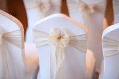 Wedding Seating. Decorated with Peach Bows royalty free stock image