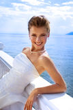 Wedding Series: Beautiful Bride at the Water Veiw. Wedding Series: Beautiful bride looking at camera at the water view in the sunny day Stock Photo