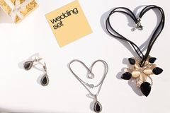 Wedding set: Necklaces forming shape of heart, earrings and jewelry box Stock Images