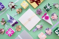 Wedding set - ornate paper boxes, decoration flowers and gifts. Top view Stock Photo
