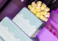 Wedding set-up. Wedding cake, close-up. Beautiful flowers decoration for wedding cake Royalty Free Stock Photo