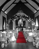 Wedding set up for civil marriage in chapel in Sligo. Chairs and red carpet ready in the Church for wedding Stock Photo