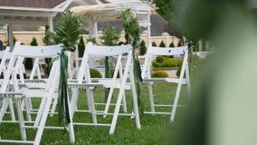 Wedding set up in garden, park. outside wedding ceremony, celebration. wedding aisle decor. Rows of white wooden empty Royalty Free Stock Images