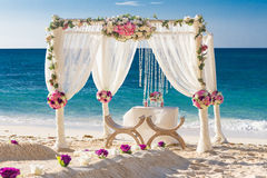 Wedding set up, tropical outdoor wedding reception, beauti. Beach wedding set up, tropical outdoor wedding reception, beautiful cabana, wedding arch Royalty Free Stock Photography