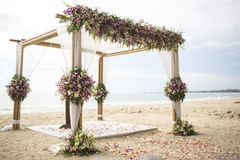 Wedding setting. On the beach stock photos