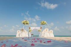 Wedding setting on the beach Stock Photos