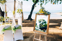 Wedding setting, beautiful, romantic ceremony decor on beach with waves background Stock Images