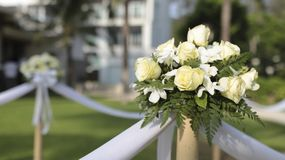 Wedding setting. Flowers hanging on the bamboo at wedding stock photography