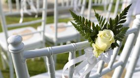 Wedding setting. Flowers hanging on the chair at wedding Royalty Free Stock Photos