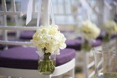 Wedding setting. Flowers hanging in mason jar at wedding stock photo
