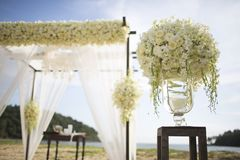 Wedding setting. Flowers  in mason jar on table at wedding Stock Photo