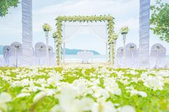 Romantic Wedding setting on the grass green and beach. stock images
