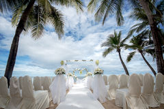 Wedding setting on a tropical beach Royalty Free Stock Photo