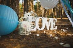 Wedding settings. Love - wooden inscription. Royalty Free Stock Image