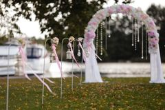 Wedding Setup decoration during Reception - Tender pink and white color - Outdoor beautiful arch stock image